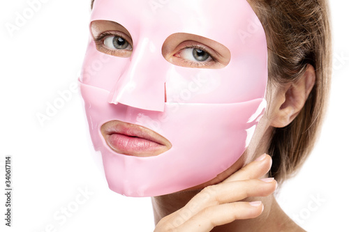 Obraz na plátně Young beautiful woman with rubber facial mask on her face