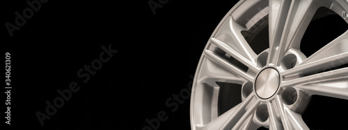 Photo new aluminum alloy wheel, silver color on a black background
