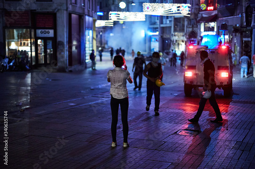 Canvastavla Using her mobile phone, a woman records civil unrest on the streets of Istanbul