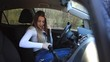 Beautiful Young Woman Fastens the Seatbelt, Starts Engine and Begins Driving.