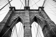Grayscale low angle shot of a Brooklyn Bridge in New York City