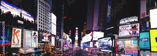 Illuminated Buildings At Times Square In City During Night - fototapety na wymiar