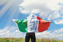 Man Waving  Italy Flag Against...