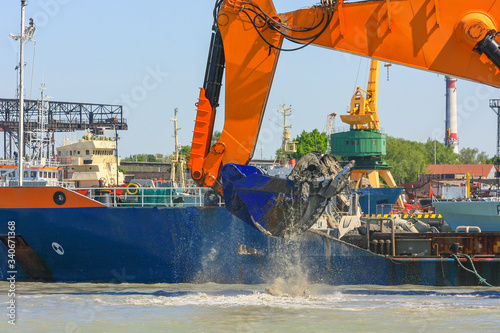 Ship with working excavator on board Canvas-taulu