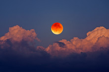 Big Blood Moon With Yellow Clouds In Blue Sky