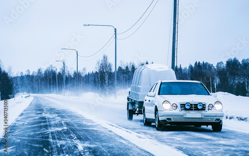 Valokuvatapetti Car with trailer and winter snowy road at Rovaniemi reflex