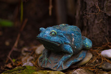 Decorative Ceramic Green Frog On The Grass In The Garden