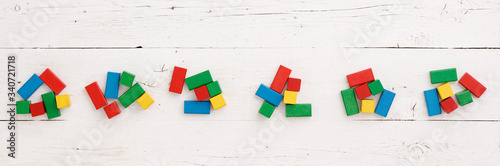 Papel de parede Top view on wooden colorful bricks on a white wooden background