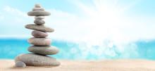 Pyramid Of Sea Pebbles On A Su...