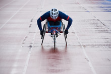 Physically Impaired Male Athlete Coming Towards Finish While Racing