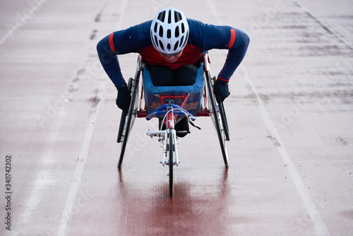Paraplegic male athlete training speed while racing in sport wheelchair Fototapet