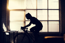 Asian Woman Cyclist. She Is Ex...