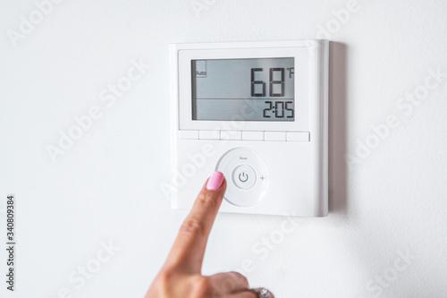 Man adjusting the thermostat Canvas Print
