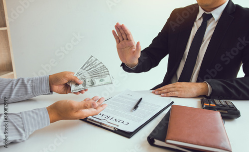 Business person refusing bribe given money by partner with anti bribery corruption concept Fototapet