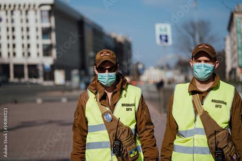 Kiev, Ukraine, March 28, 2020, Two police officers at facial protective masks at Slika na platnu