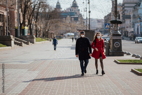 Fotografija Kiev, Ukraine, March 28, 2020, Ukrainian people at facial protective masks at al