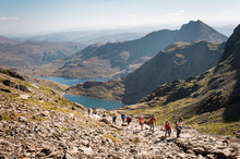 People Walking Up Mount Snowdon In Wales