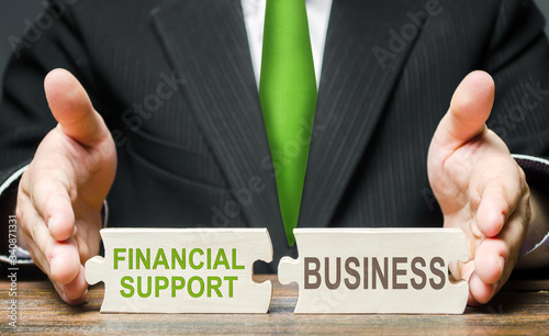 Man connects two puzzles providing financial support to business in a crisis situation Canvas Print