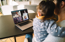 Woman Teleconferencing With Family On Laptop