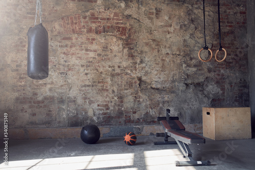 Canvas Gym with old brick wall with sports equipment