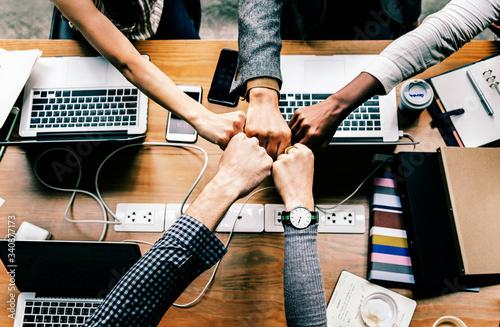 Colleagues giving a fist bump Fotobehang
