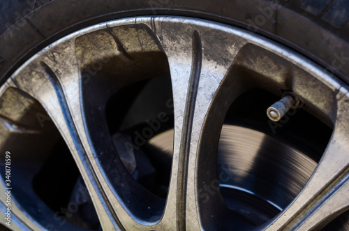 Photo Alloy wheel with dirt and oil.