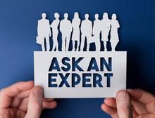 Hands Holding An Ask An Expert...