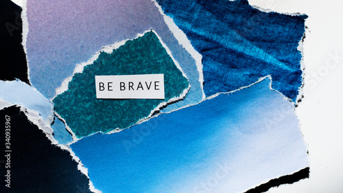 cutout collage, artistic picture with the inscription be brave Wallpaper Mural
