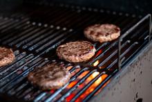 Hamburgers On Grill With Danci...