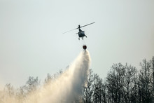 Helicopter Dropping Water On F...