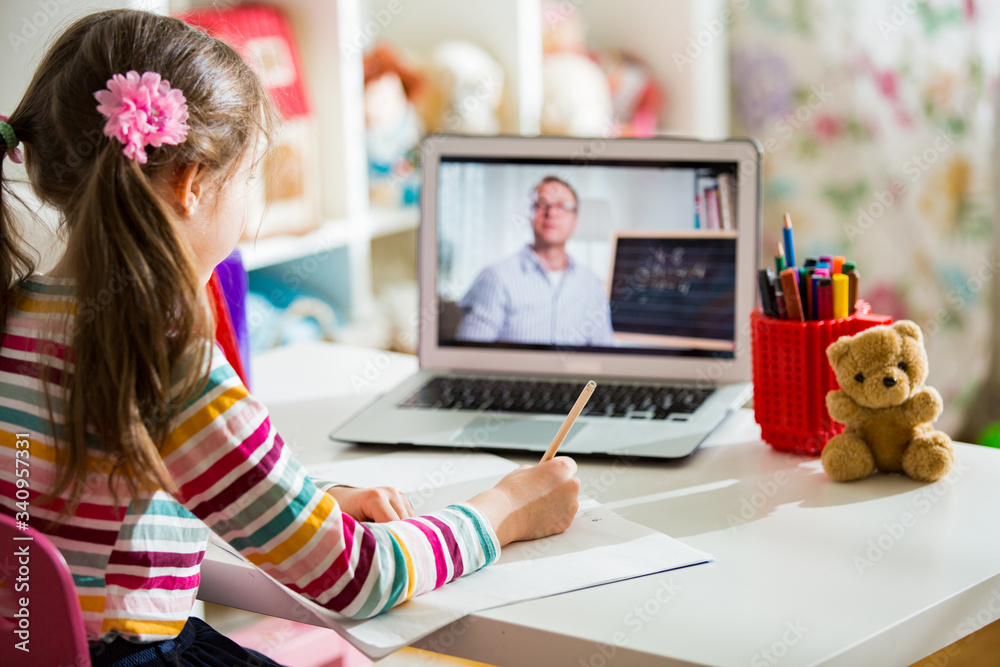 Fototapeta Middle-aged distance teacher having video conference call with pupil using webcam. Online education and e-learning concept. Home quarantine distance learning and working from home.