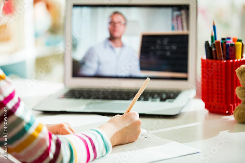 Middle-aged distance teacher having video conference call with pupil using webcam Fototapete