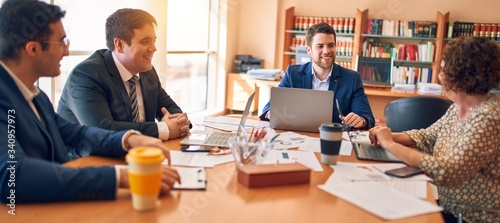 Fototapeta Business lawyers workers meeting at law firm office. Professional executive partners working on finance strategry at the workplace obraz