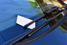 Close Up Of Parking Fine On Car Windscreen.