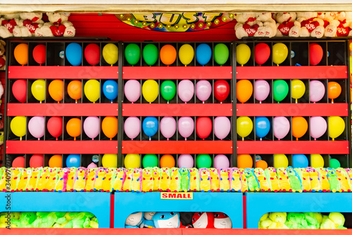 balloons and prizes at a dart throwing game booth at a carnival, fair, or amusem Canvas-taulu