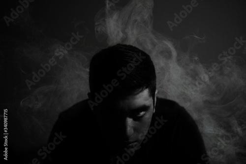 Obraz Portrait Of Man Surrounded By Smoke - fototapety do salonu