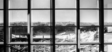 Scenic View Of Mountains Seen Through Glass Window