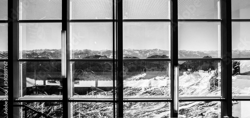 Photo Scenic View Of Mountains Seen Through Glass Window