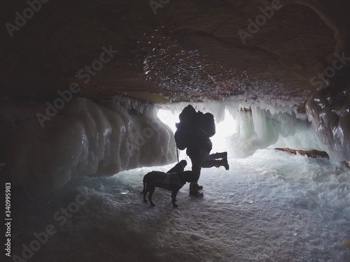 Fotomural People With Dog In Frozen Cave