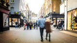 Motion blurred high street shoppers
