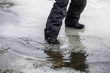 Child Stomping In A Puddle Wit...