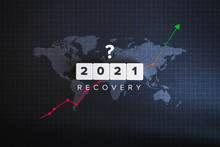 Global Recovery And World Economy 2021 Concept. Block Letters, World Map And Financial Chart On Black Background.