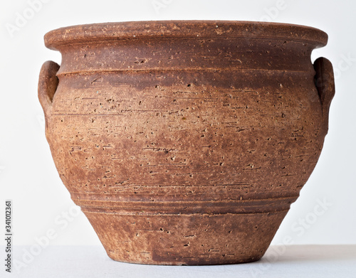 ceramic flowerpot in the shape of an ancient clay vase in brown color Canvas Print