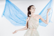 A Trash Angel. The Girl Froze In A Desperate Pose. The Woman Is Wearing A Garbage Bag. Behind The Girl's Back Are Wings From A Blue Plastic Garbage Bag. The Girl's Skin Is Like Porcelain.
