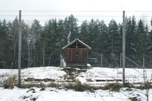 Chainlink Fence In Front Of Barn During Winter