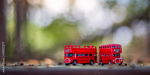 Obraz na plátně toys that represent two of the main symbols of the city of London, double-decker bus on blurred background