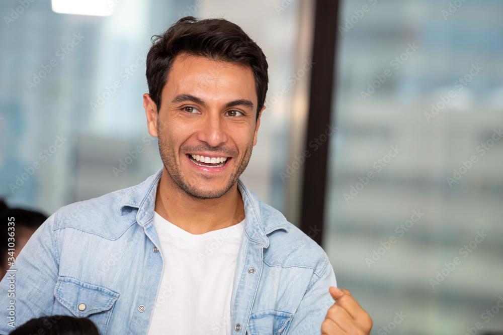 Fototapeta Handsome man smiling in the office, Feeling positive concept