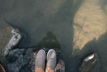Female Feet In Sneakers On A S...