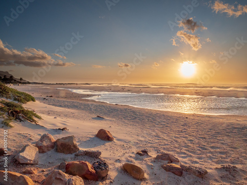 Fototapeta South African beach life with an amazing sunset view