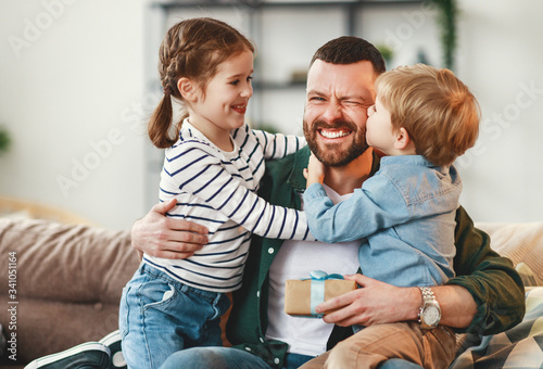 Happy father getting congratulations from kids. Poster Mural XXL